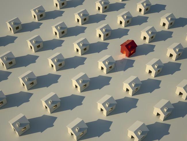 Flere rekker med hvite hus, og ett rødt hus midt i